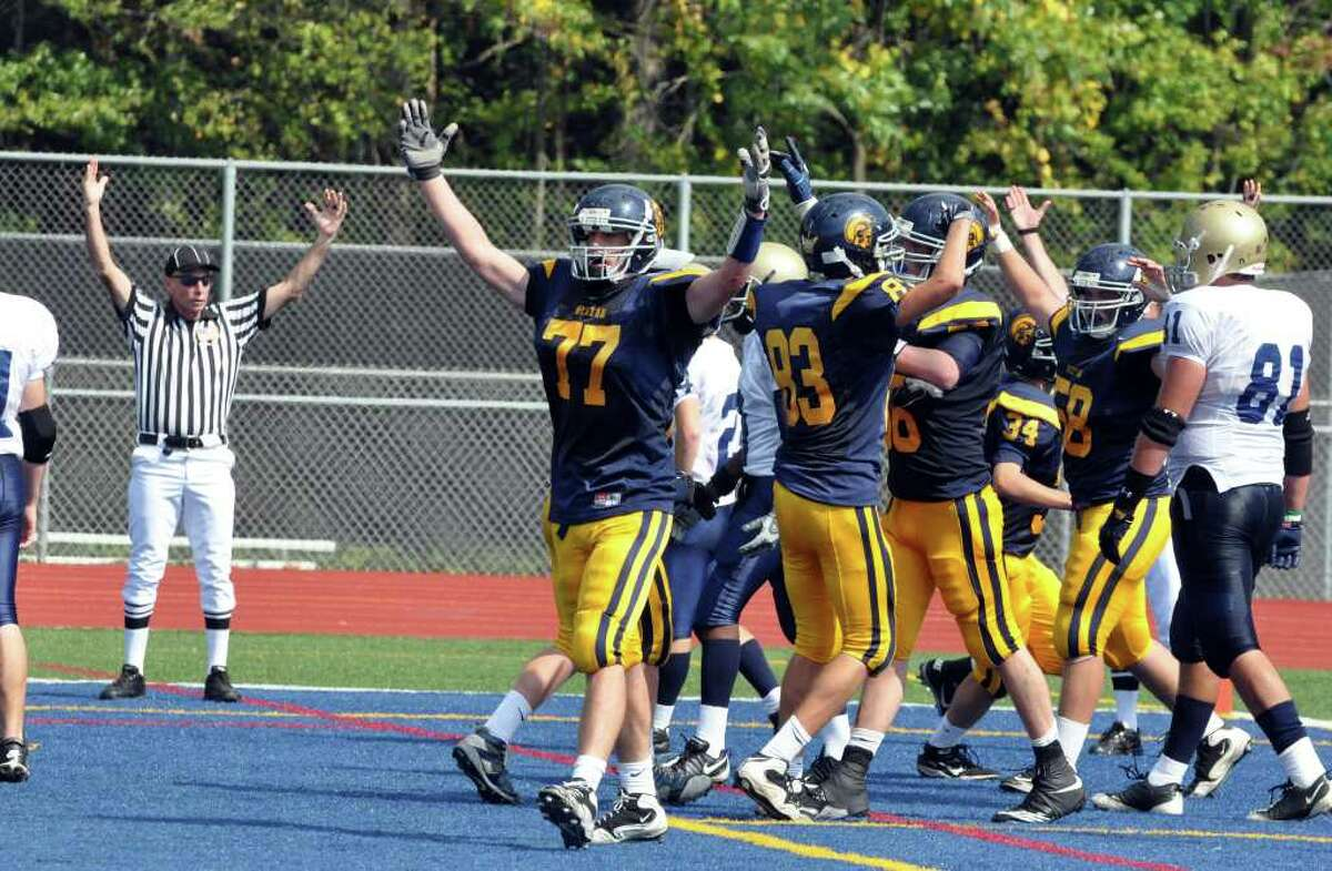 Weston's Carmine Magnoli celebrates with his team in the endzone during the first half of the football game against Notre Dame Fairfield at Weston on Saturday, Sept. 25, 2010. Crowell broke up three passes.