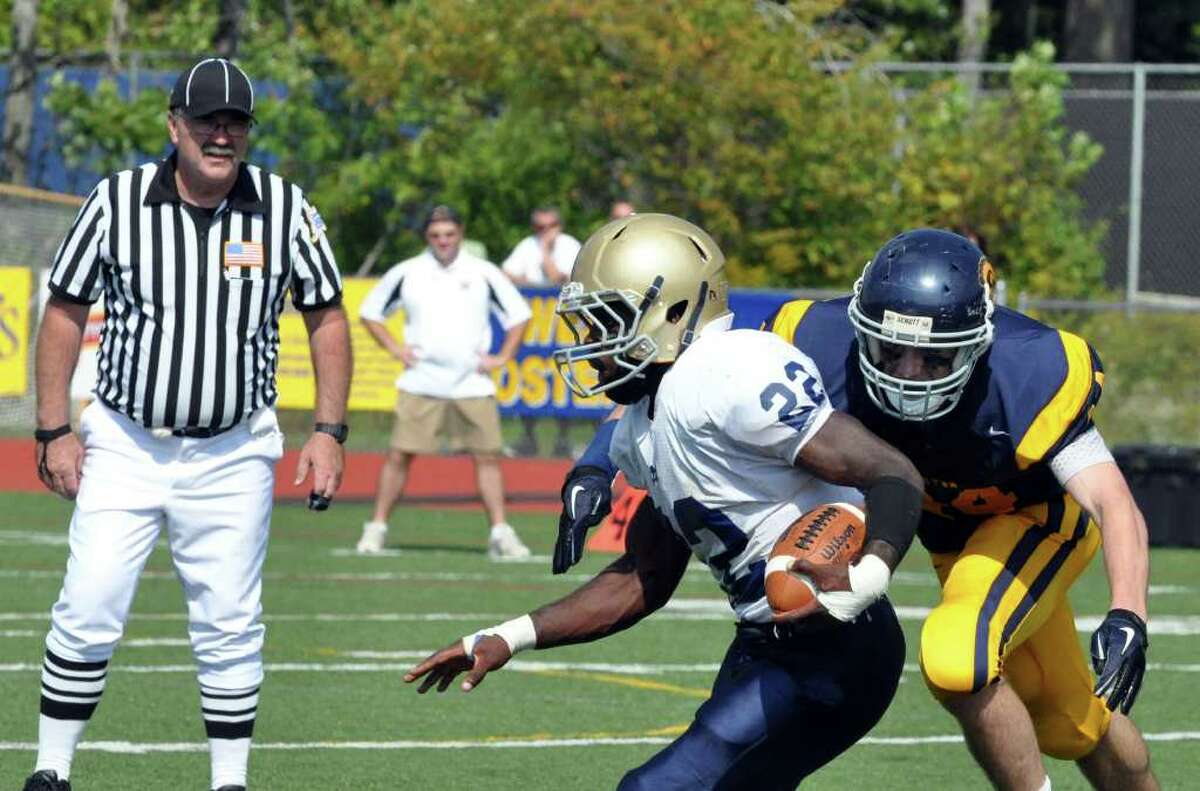 Weston's Jacob Spencer attemps to stop Notre Dame Fairfield's Nigel Beckford during the first half of the football game at Weston on Saturday, Sept. 25, 2010. Crowell broke up three passes.
