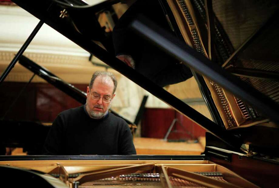 American pianist Garrick Ohlsson plays during the rehearsal for the Special Concert on the 200th Anniversary of Fryderyk Chopin's Birth at Warsaw Philharmonic February 25, 2010. Ohlsson will play an all-Chopin program Thursday, Sept. 30, at Troy Savings Bank Musical Hall in Troy.(Kacper Pempel / Reuters) Photo: (c)  / X02307