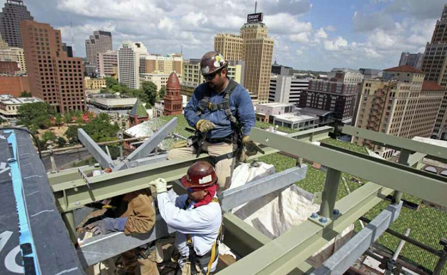 Welders fix beams into place in the top floor of Bexar County's new Justice Center Tower last week.