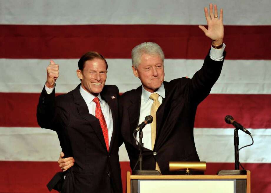 Former President Bill Clinton, right, campaigns for Democratic U.S. Senate candidate Richard Blumenthal, left, in New Haven, Conn., on Sunday, Sept. 26, 2010.  (AP Photo/Jessica Hill) Photo: AP