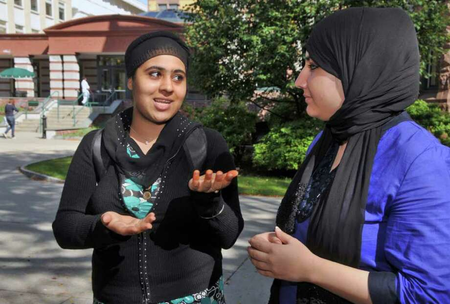 Afghan students, Yagana, left, and Meena whose last names have been omitted to protect their safety, at Russell Sage College Thursday morning September 23, 2010.  (John Carl D'Annibale / Times Union) Photo: John Carl D'Annibale / 00010380A