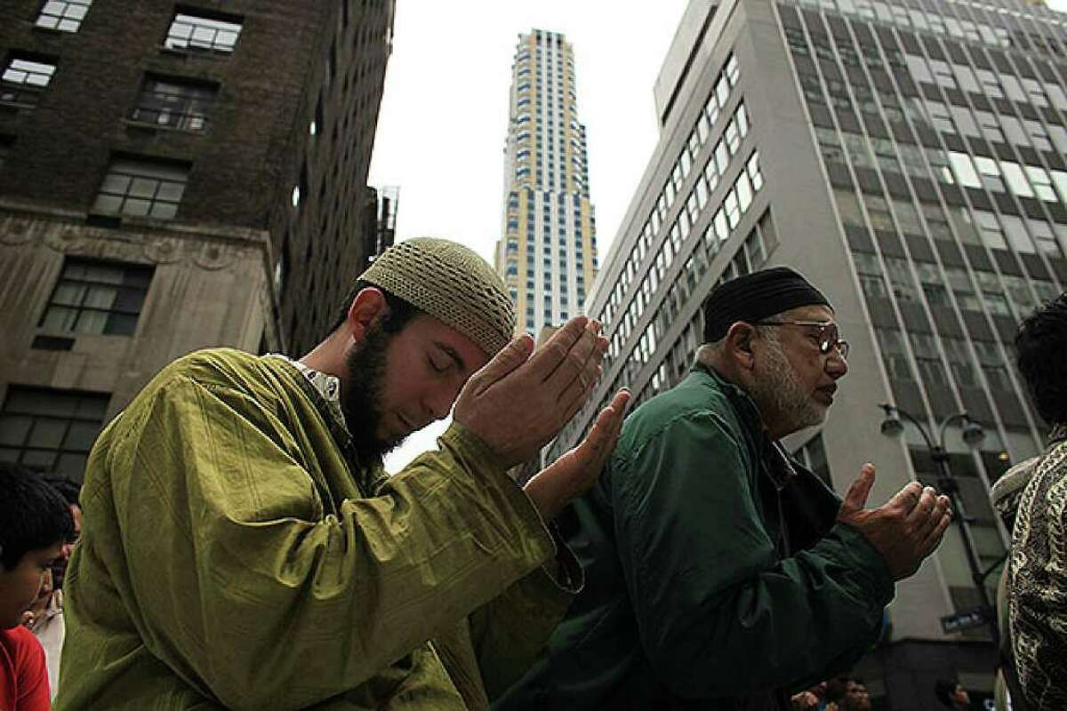 NEW YORK - SEPTEMBER 26: Men pray on the street before the start of the American Muslim Day Parade on September 26, 2010 in New York, New York. The annual parade celebrates the presence and contributions of Muslims in New York City and surrounding areas. The parade, which attracts hundreds of participants, concludes with a bazaar selling food, clothing, and books from various Muslim nations. (Photo by Spencer Platt/Getty Images)