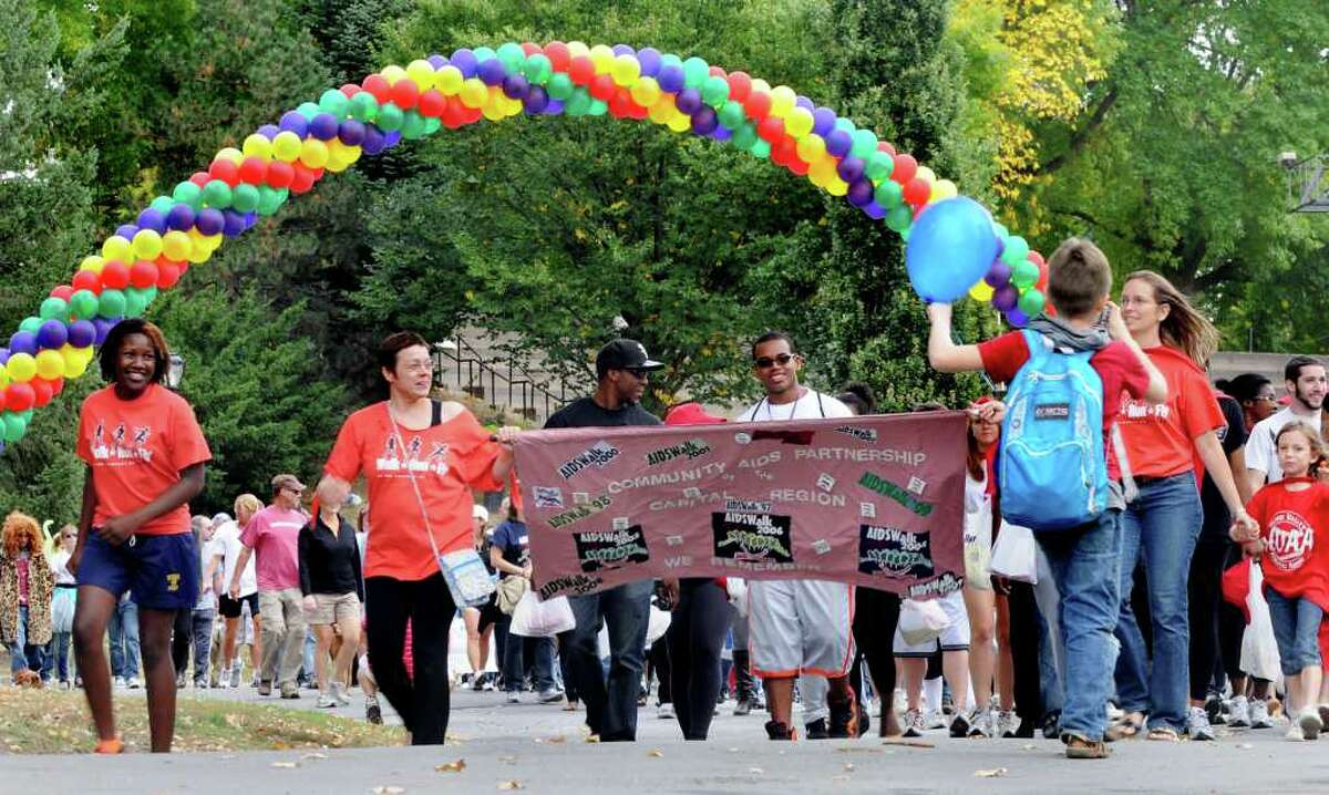 Walkers proceed along the course of the 14th annual AIDSWalk and 5K Run on Sunday in Albany's Washington Park. (Cindy Schultz / Times Union)