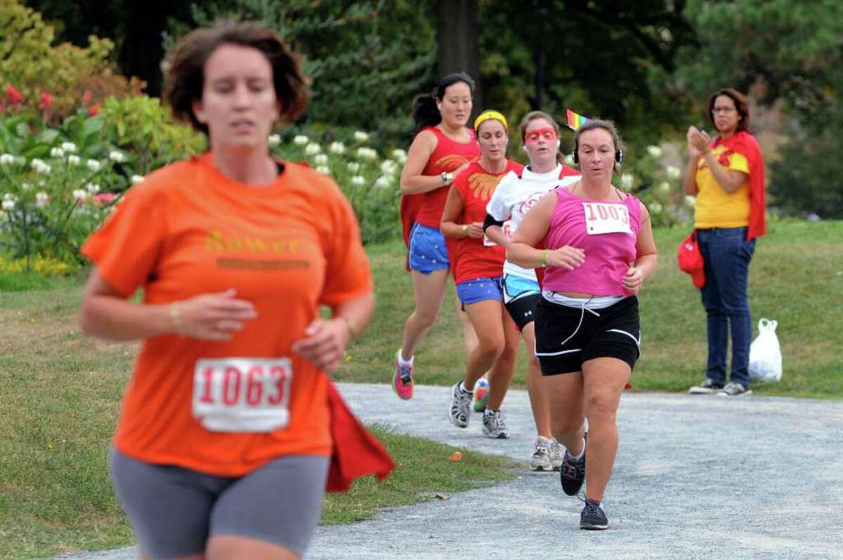 Runners take a turn along the course of the 14th annual AIDSWalk and 5K Run on Sunday in Albany's Washington Park. (Cindy Schultz / Times Union)