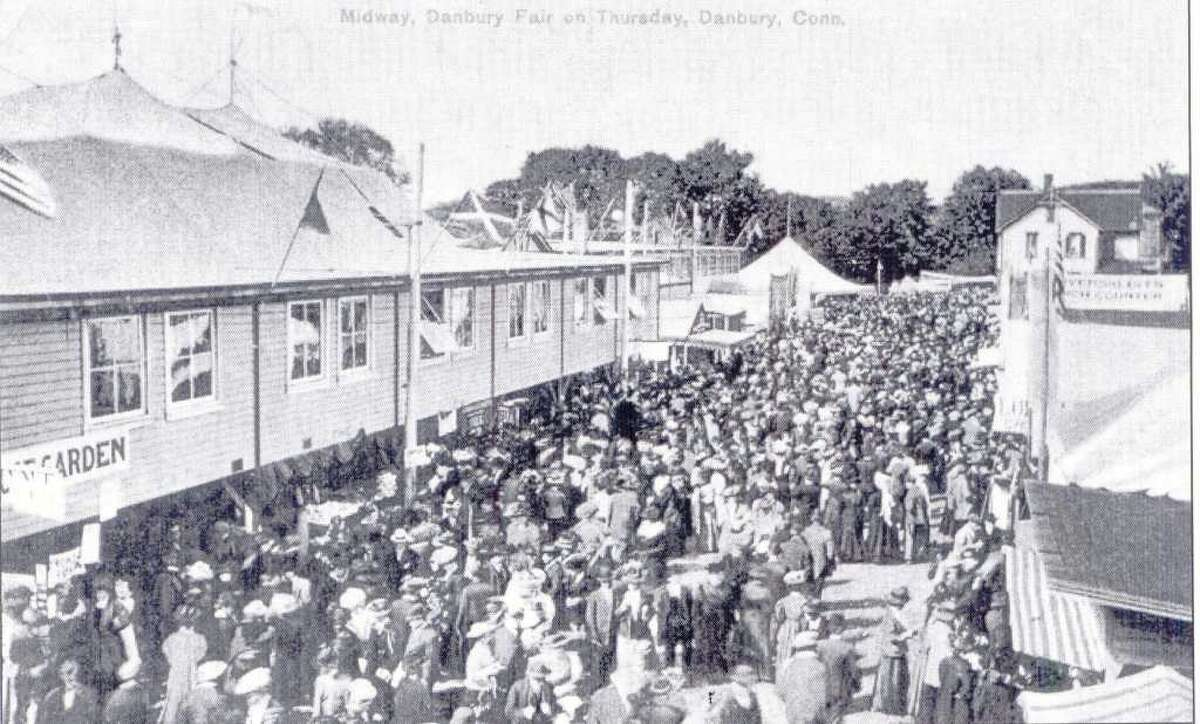 The Danbury Fair took place each autumn for many years, until it closed in 1981. This postcard shows the midway during the 1908 fair. Postcard from the collection of George Franklin of Brookfield.
