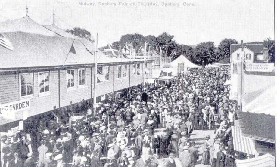 The Danbury Fair took place each autumn for many years, until it closed in 1981. This postcard shows the midway during the 1908 fair. Postcard from the collection of George Franklin of Brookfield. Photo: Contributed Photo / The News-Times Contributed