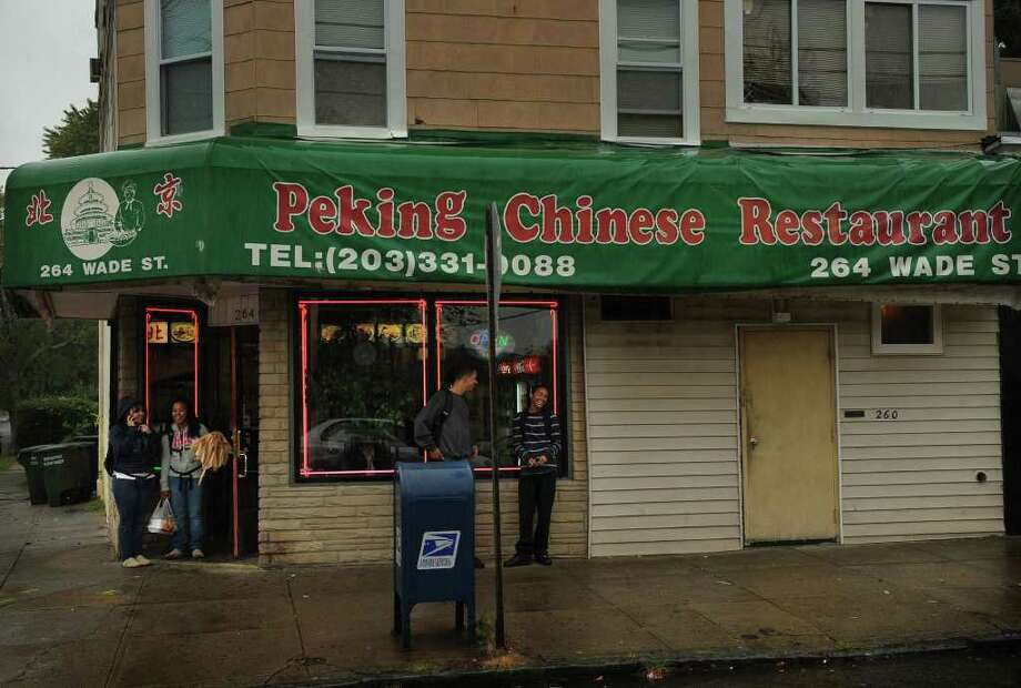 The Peking Chinese Restaurant at 264 Wade Street in Bridgeport where an employee shot and killed one of two men who allegedly came to rob the restaurant on Sunday night. Photo: Brian A. Pounds / Connecticut Post