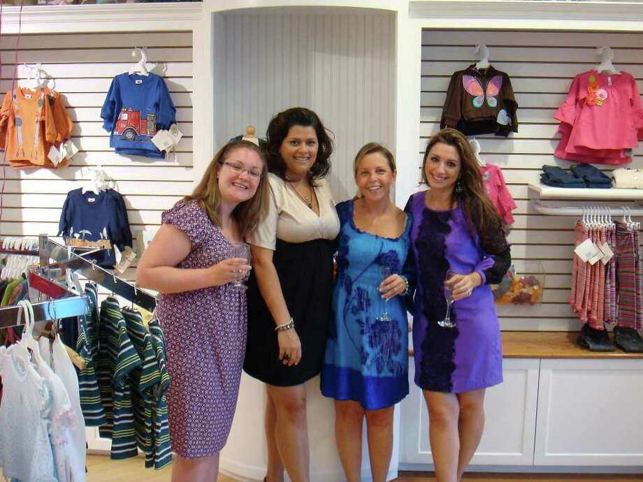 Sales Associate Cindy Cotter, Store Manager Julissa Alvarado, Simply Baby and Kids favorite customer Corry Ioli, and Assistant Store Manager Kara Telep p at the store's soft opening last week.  The Newtown shop had its grand opening on Saturday. Photo: Contributed Photo / The News-Times Contributed