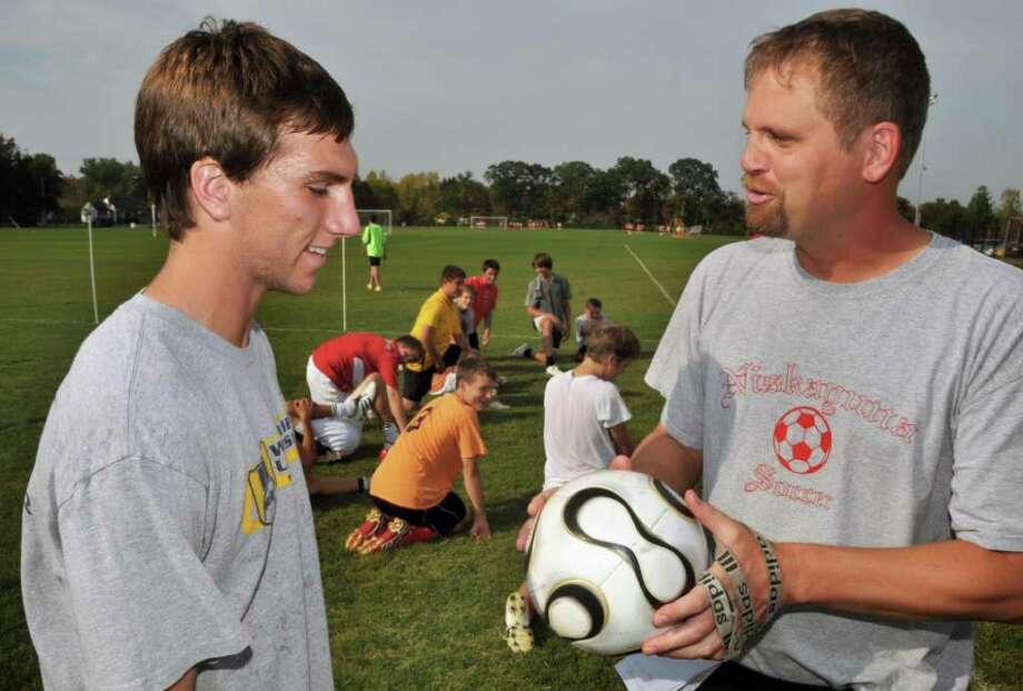 High school boys' soccer -- Niskayuna coach Jeff Ormsbee, right, says midfielder Ryan Tauss makes plays he has never seen before on a high school boys' soccer field.   (John Carl D'Annibale / Times Union) Photo: John Carl D'Annibale / 00010389A