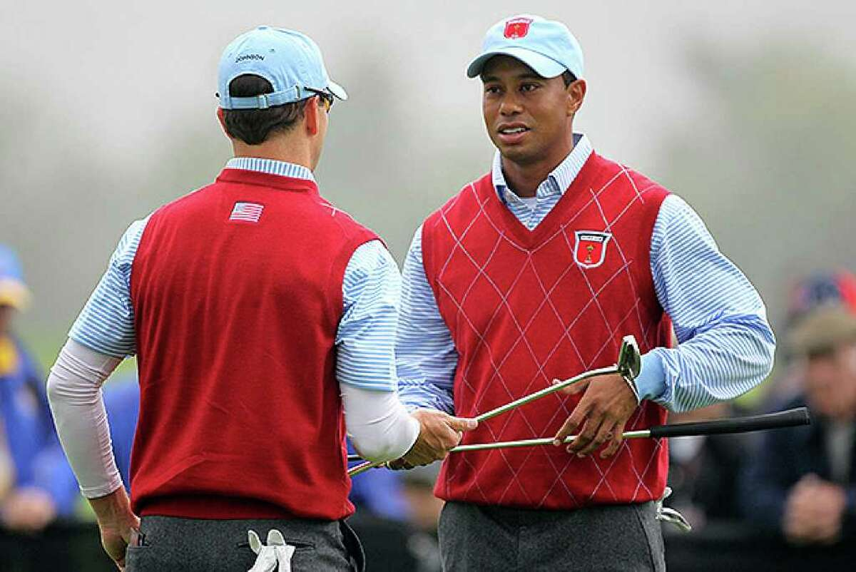 NEWPORT, WALES - SEPTEMBER 28: Tiger Woods of the USA chats with Zach Johnson (L) during a practice round prior to the 2010 Ryder Cup at the Celtic Manor Resort on September 28, 2010 in Newport, Wales. (Photo by Andy Lyons/Getty Images) *** Local Caption *** Tiger Woods;Zach Johnson