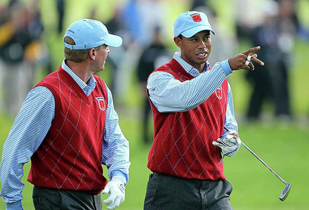 NEWPORT, WALES - SEPTEMBER 28: Tiger Woods of the USA chats with Steve Stricker (L) during a practice round prior to the 2010 Ryder Cup at the Celtic Manor Resort on September 28, 2010 in Newport, Wales. (Photo by Andy Lyons/Getty Images) *** Local Caption *** Tiger Woods;Steve Stricker