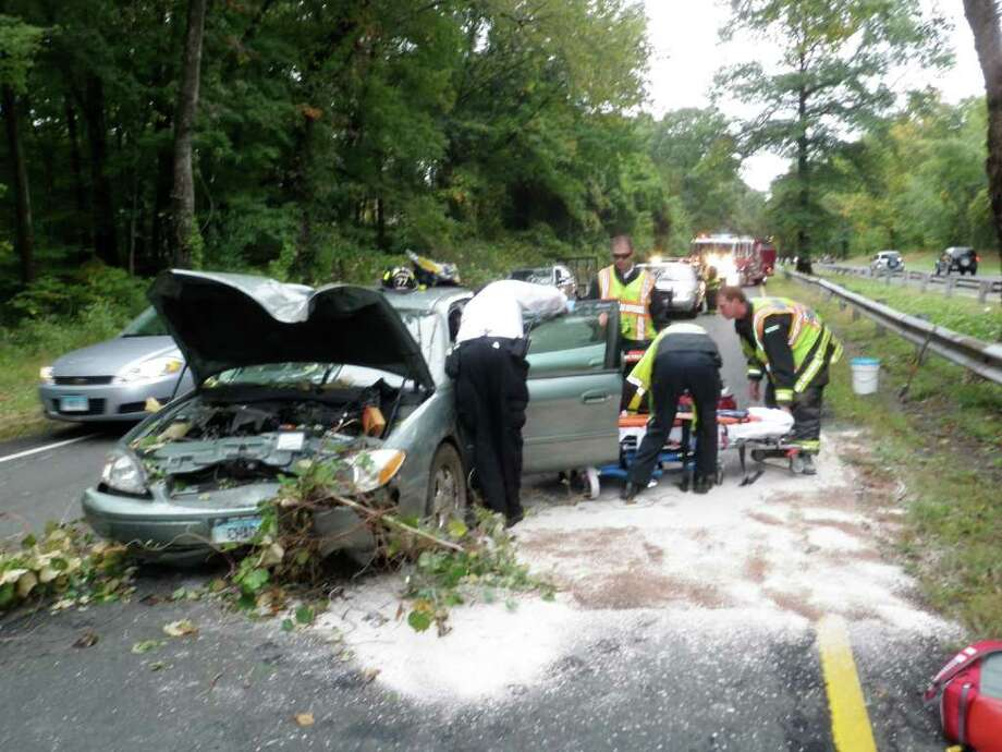 Firefighters and other emergency personnel work at the scene of a two-car accident on the Merritt Parkway in Westport on Tuesday, Sept. 28, 2010. Photo: Contributed Photo / Westport News