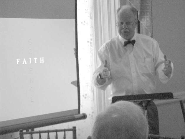 "Dr. Dickerman Hollister addresses the question ""Does faith heal?"" during a recent presentation. Photo: Anne W. Semmes / Greenwich Citizen"