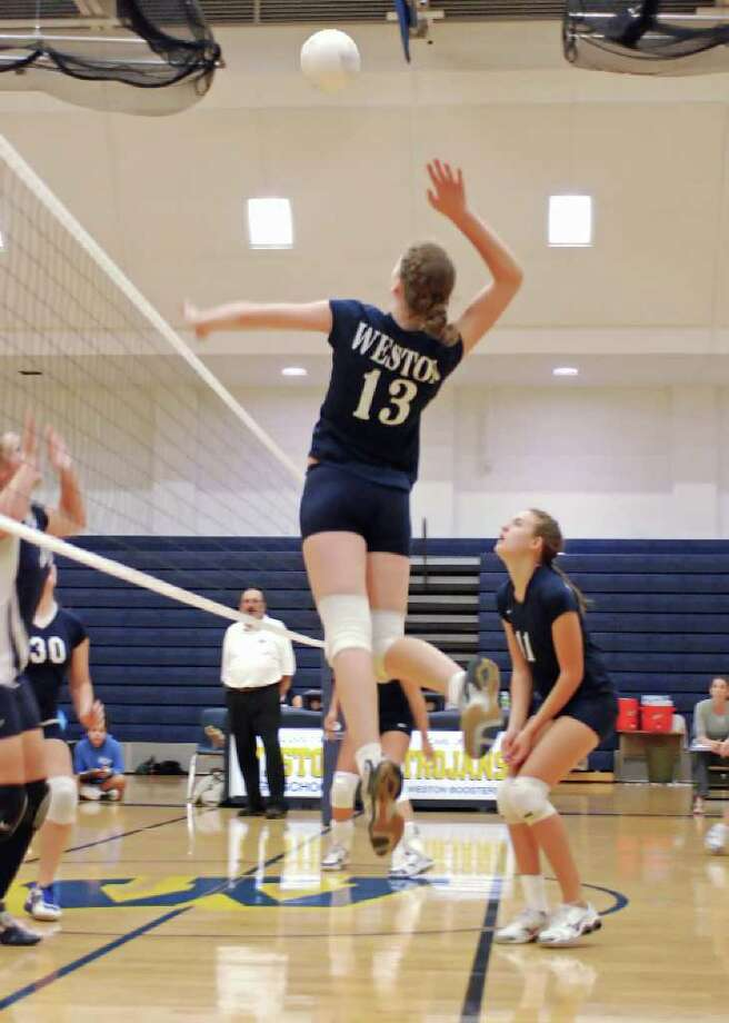 Weston senior captain Christina Welsh drills a kill in a 3-0 home victory over Oxford on Monday. According to Lady Trojans Coach Jamie Charles, Welsh has been a true asset at every position for 4-1 Weston. Photo: Contributed Photo / Steven L. Gersh