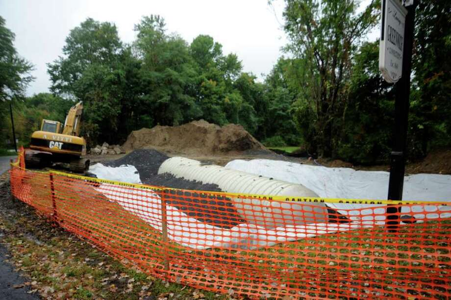 A 30,000-gallon fiberglass cistern has been placed by the fire department in the ground near the edge of the road at 1400 King St., on Tuesday, Sept. 28, 2010. Photo: Helen Neafsey / Greenwich Time