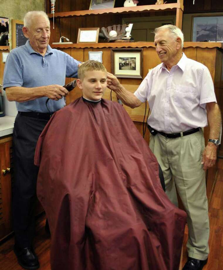 Brothers, Paul LaReau and Emile LaReau, cut 13-year-old Patrick Warren's hair on Tuesday Sept. 29, 2010 at Emile's Barber Shop in Stratford. Photo: Lauren Stevens / Connecticut Post