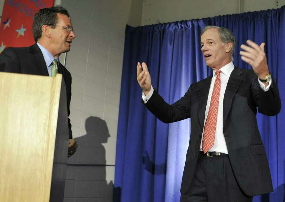Democratic candidate for governor Dan Malloy, left, and Republican candidate Tom Foley, right, speak prior to a debate in Middletown, Conn., on Tuesday, Sept. 28, 2010.   (AP Photo/Jessica Hill) Photo: AP