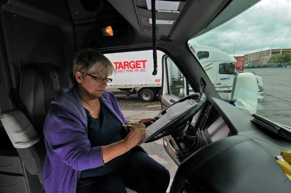 Truck driver Virginia May of Peoria, Il., prepares to leave for a cross-country trip with her husband, Randall, from the Port of Albany truck stop in Albany on Tuesday. The state's plan to close six rest stops jeopardizes the safety or truckers and others using the highways, she said. ( Philip Kamrass / Times Union )