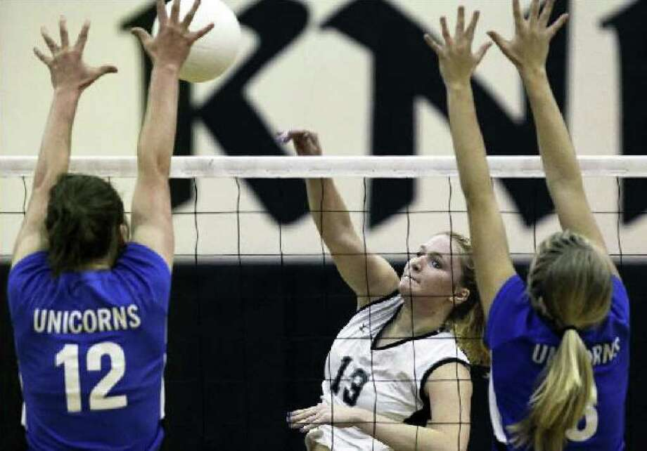 Steele's Rebekah Rightnour (center) hits a shot during Tuesday's victory over New Braunfels at Steele High School. The Knights, now in 25-5A, have won 25 straight district matches.