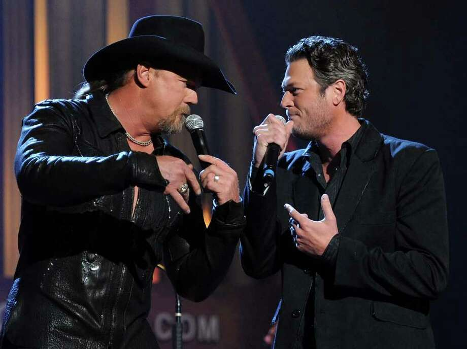 NASHVILLE, TN - SEPTEMBER 28:  Recording Artists Trace Adkins and Blake Shelton perform during Country Comes Home: An Opry Celebration at the Grand Ole Opry House on September 28, 2010 in Nashville, Tennessee. The Grand Ole Opry House has been restored following damage sustained during flooding in May 2010.  (Photo by Rick Diamond/Getty Images) *** Local Caption *** Trace Adkins;Blake Shelton Photo: Rick Diamond, Getty Images / 2010 Getty Images