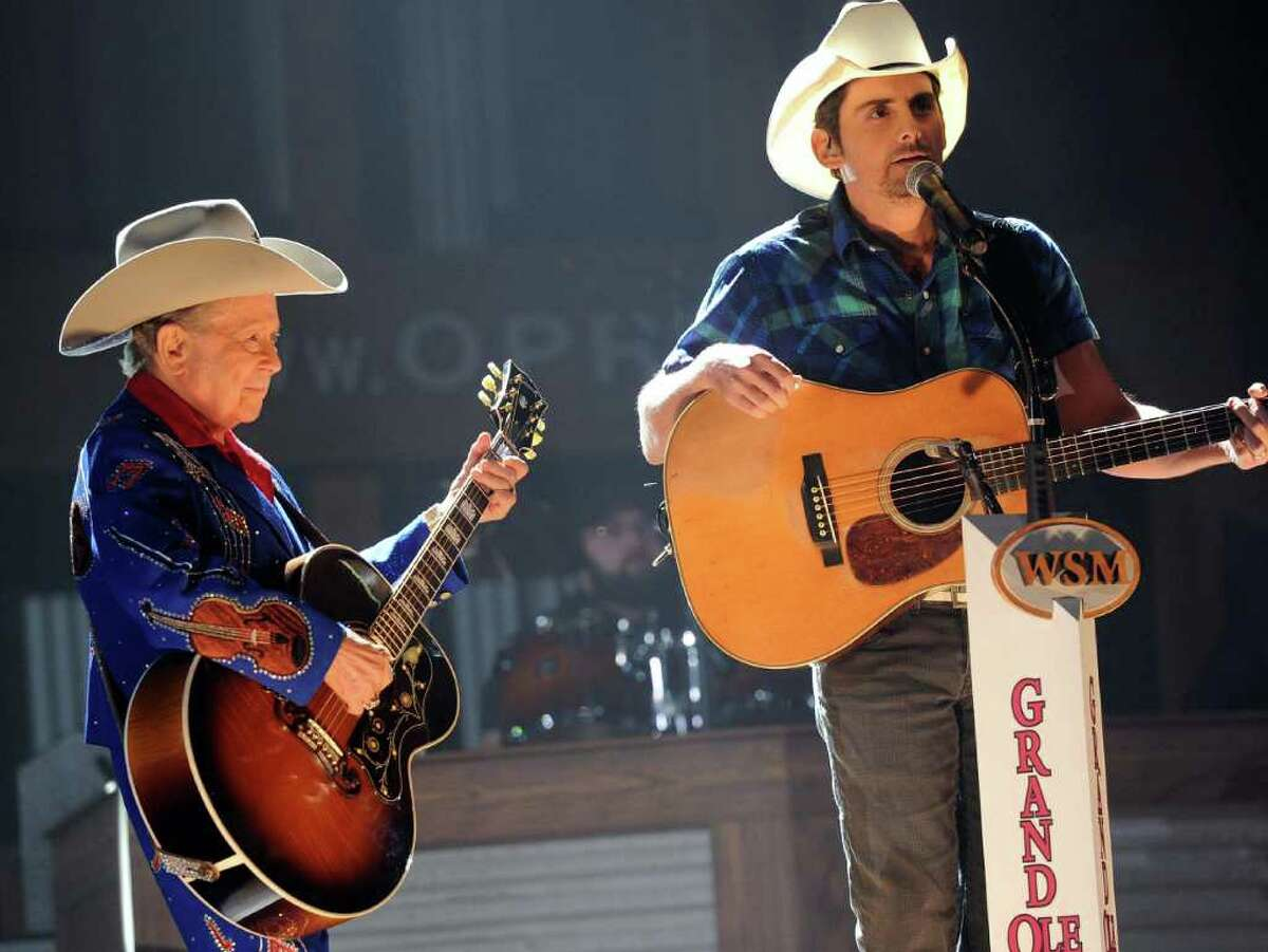 NASHVILLE, TN - SEPTEMBER 28: Recording Artists Little Jimmy Dickens and Brad Paisley perform during Country Comes Home: An Opry Celebration at the Grand Ole Opry House on September 28, 2010 in Nashville, Tennessee. The Grand Ole Opry House has been restored following damage sustained during flooding in May 2010. (Photo by Rick Diamond/Getty Images) *** Local Caption *** Little Jimmy Dickens;Brad Paisley