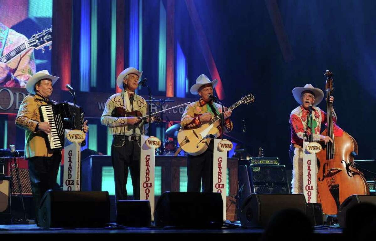 NASHVILLE, TN - SEPTEMBER 28: Recording Artists Riders in the Sky perform during Country Comes Home: An Opry Celebration at the Grand Ole Opry House on September 28, 2010 in Nashville, Tennessee. The Grand Ole Opry House has been restored following damage sustained during flooding in May 2010. (Photo by Rick Diamond/Getty Images) *** Local Caption *** John Conlee