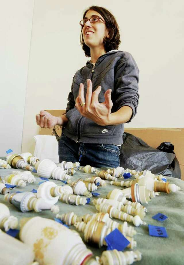 Kirsten Hassenfeld is setting up for a show with her husband, Lee Boroson, at the Ester Massry Gallery on The College of Saint Rose Campus in Albany, NY, on Wednesday, Sept. 15, 2010. (Luanne Ferris / Times Union) Photo: Luanne M. Ferris