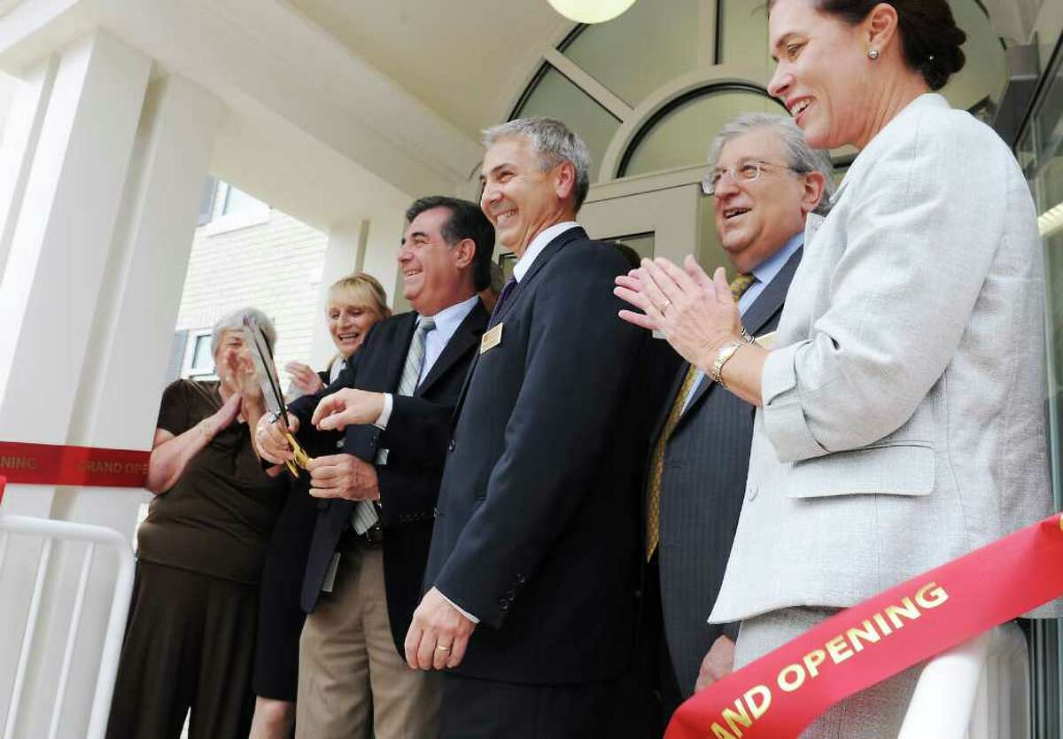 Stamford Mayor Mike Pavia joins Bob Palermo, President of First Stamford Bank, Jay Forgotson, CEO of BNC Financial Group, and Heidi DeWyngaert, President of Bank of New Canaan, at the ribbon cutting and grand opening of First Stamford Bank in Stamford, Conn. on Tuesday September 28, 2010