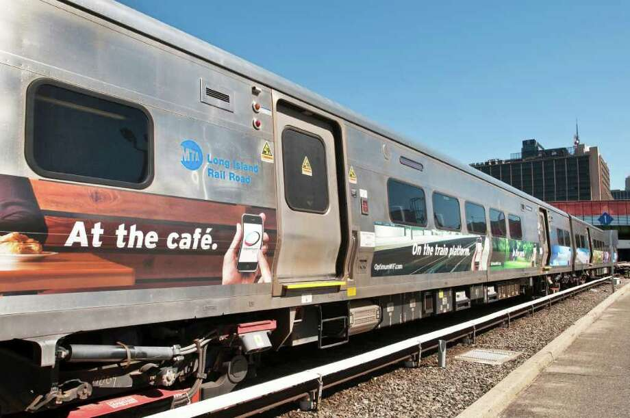 A Long Island Railroad train with an advertisement for Cablevision. The Metropolitan Transit Authority says the pilot program of placing ads on train exteriors is not generating enough revenue and will be discontinued. Photo: Contributed Photo / Stamford Advocate Contributed