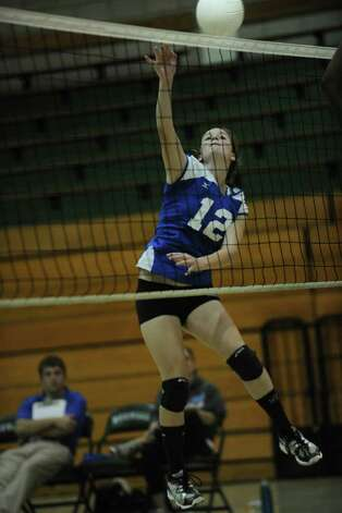 Fairfield Ludlowe's Emily Nelson spikes the ball during her team's 3-0 win over Norwalk at Norwalk High School on Monday, September 27, 2010. Photo: Brian A. Pounds / Connecticut Post