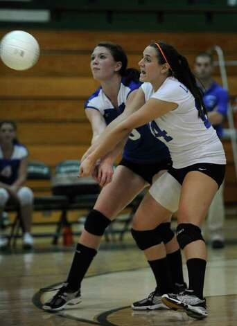 Fairfield Ludlowe's Madison McCaffrey, left, and Ashley Curtis make a play for the same ball during their team's 3-0 win over Norwalk at Norwalk High School on Monday, September 27, 2010. Photo: Brian A. Pounds / Connecticut Post