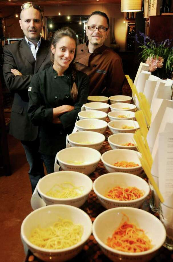 L-R: Co-owner of Chianti Restaurant, David Zecchini, and his wife Roslyn Zecchini, Executive Chef at Pasta Pane, in Clifton Park and Co-owner of Chianti Restaurant, and Fabrizio Bazzani, Chianti Restaurant Executive Chef, with the bowls of Spaghetti prepared & tested as Chianti Restaurant, on Wednesday, Sept, 22, 2010 in Saratoga Springs. (Luanne M. Ferris / Times Union) Photo: Luanne M. Ferris