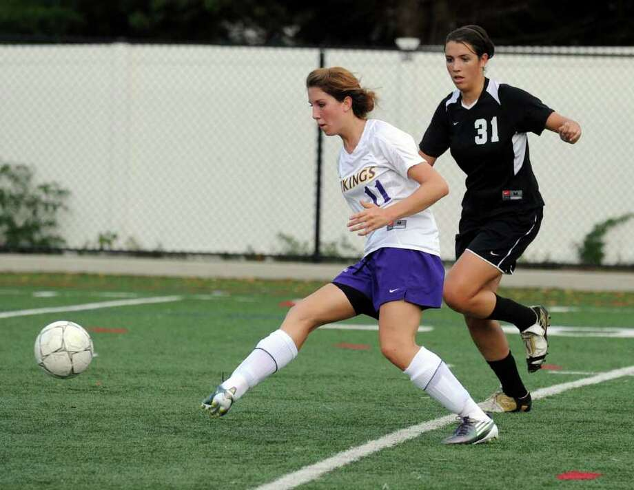 Westhill's Morgan Tanacea turns the ball as Trumbull's Marissa Pearson closes in as Westhill High hosts Trumbull High in a girls soccer game Wednesday, September 29, 2010. Trumbull won the game 1-0. Photo: Keelin Daly / Stamford Advocate