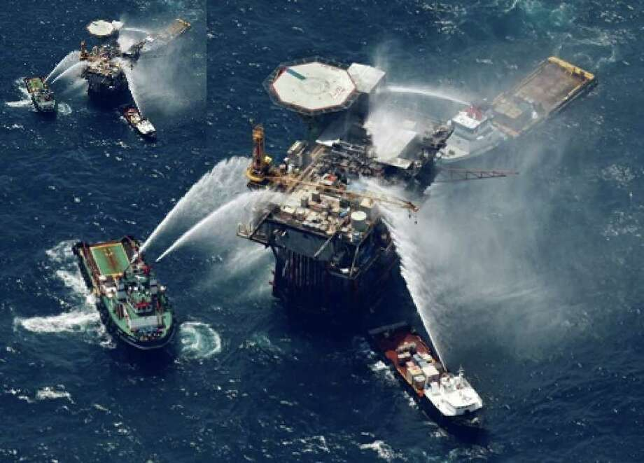 Boats spray water early this month on the Macondo oil and gas platform that exploded in the Gulf of Mexico. BP's incoming CEO plans to emphasize safety measures in reorganizing the company's leadership