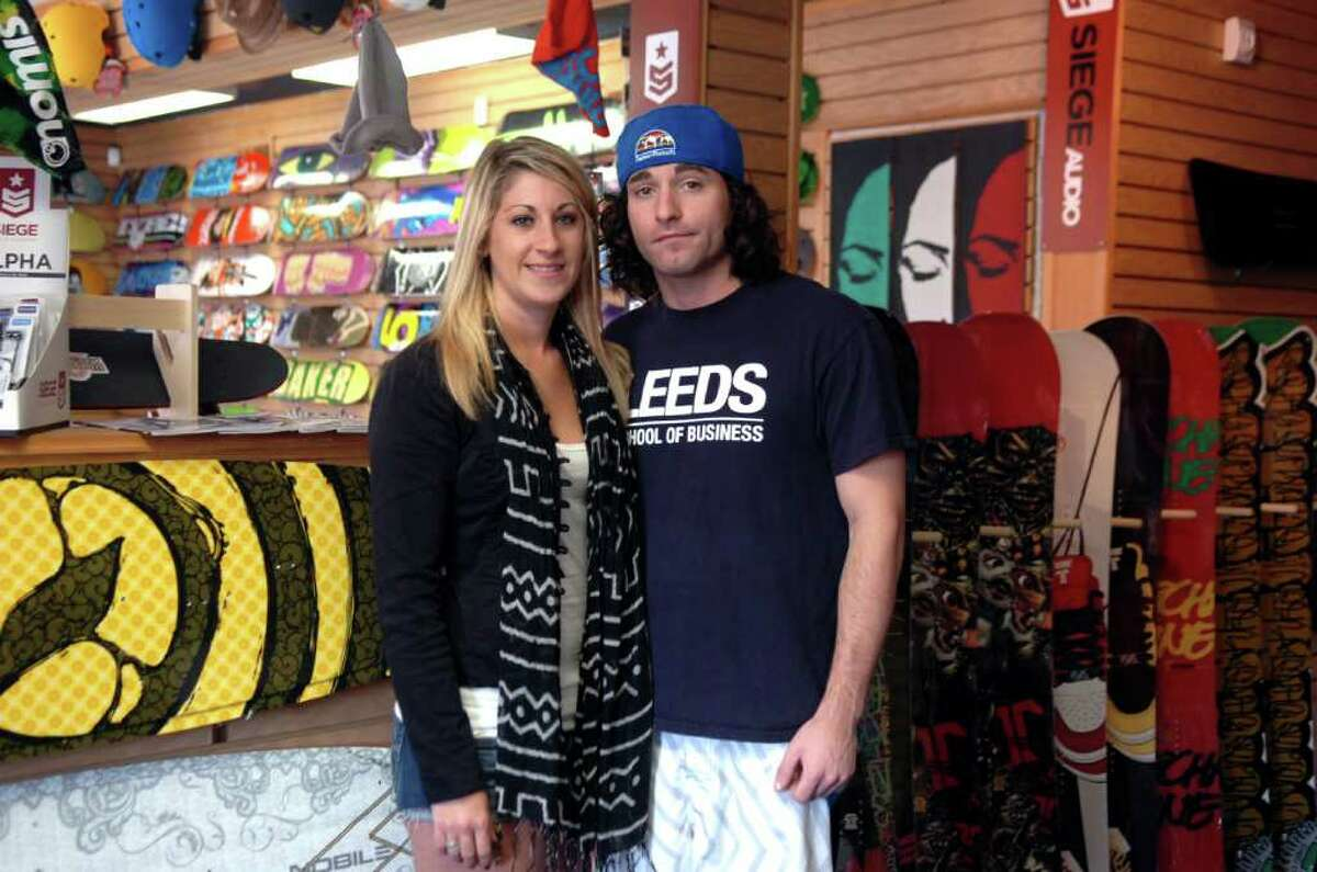 Jessica Lindsay, shop buyer and graphic designer with Joe Garan, owner of Capsule Boardshop at his new shop in Cos Cob, on Wednesday, Sept. 22, 2010.