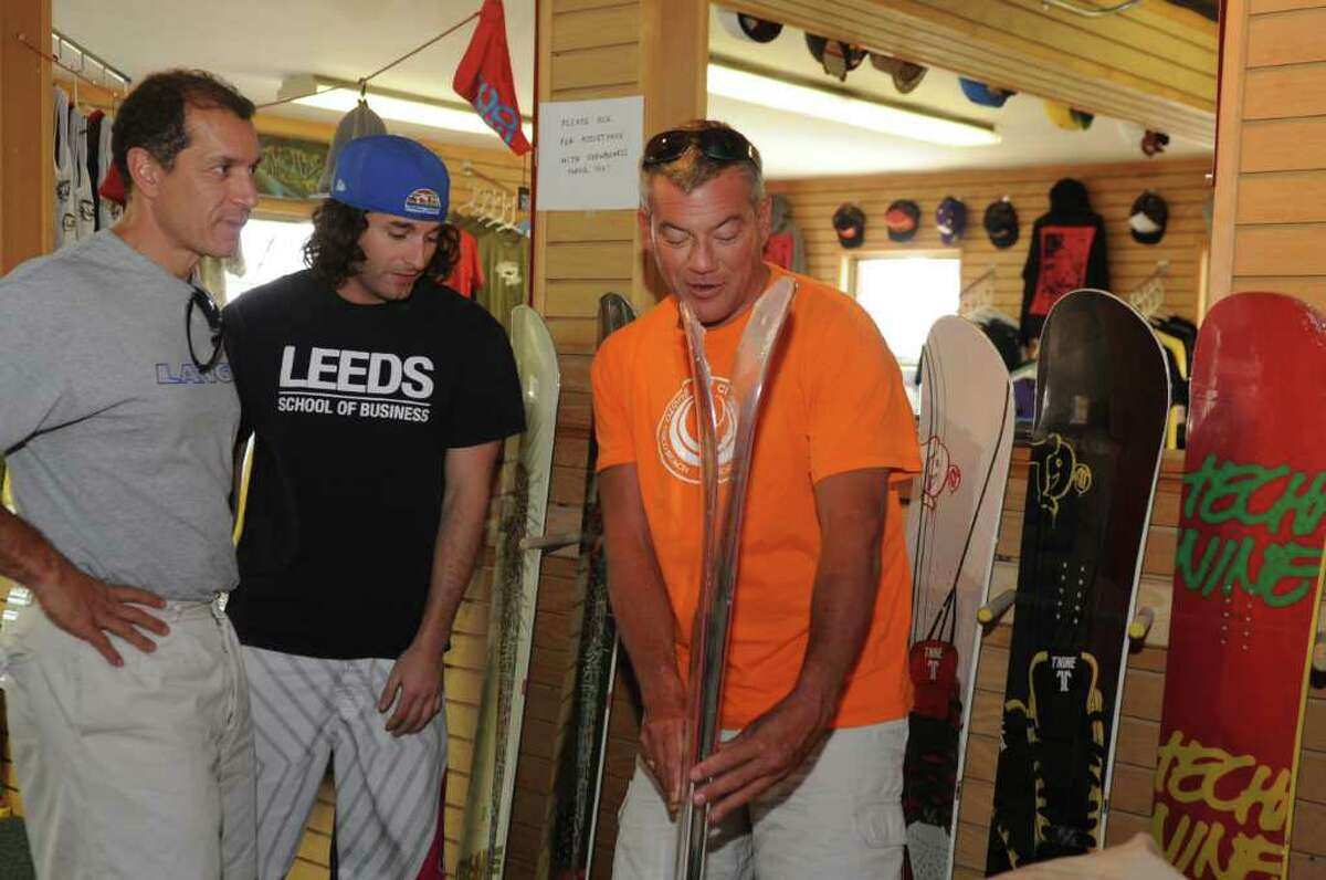 Fran Sisca, of Greenwich, Joe Garab, owner of Capsule Boardshop, and Bill Levins, of Stowe, Vermont, look at merchandise in the store, on Wednesday, Sept. 22, 2010.