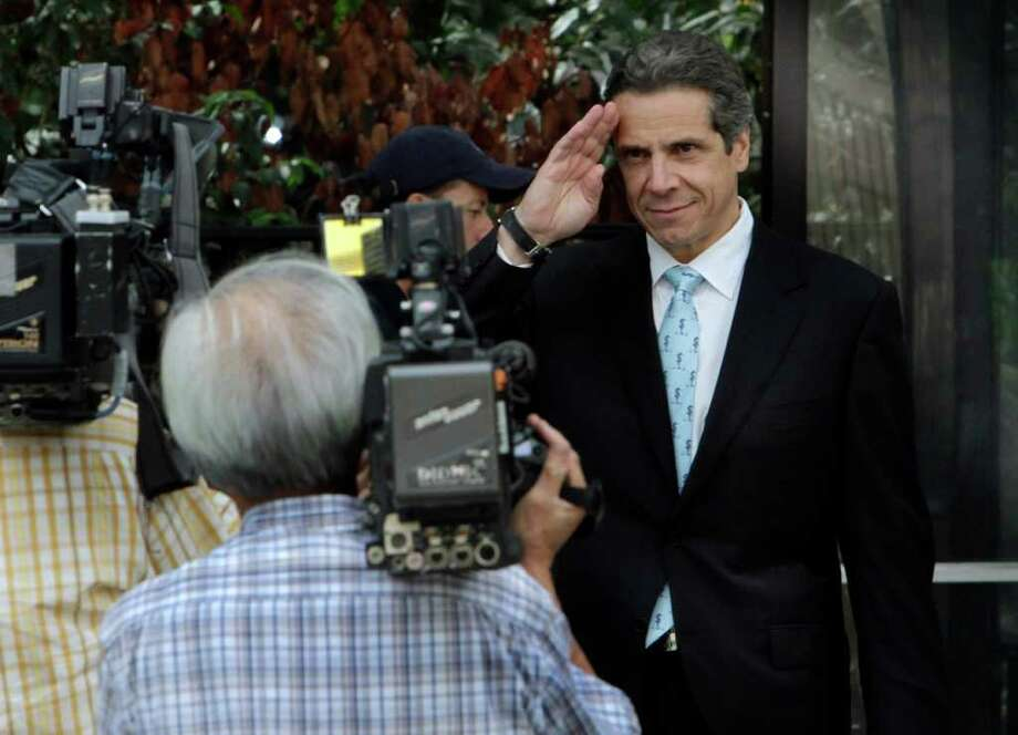 New York Democratic candidate for governor, state Attorney General Andrew Cuomo, salutes as he arrives at New York's City Hall,  Wednesday, Sept. 29, 2010. Cuomo has picked up the endorsement of a prominent abortion rights group NARAL. (AP Photo/Richard Drew) Photo: Richard Drew