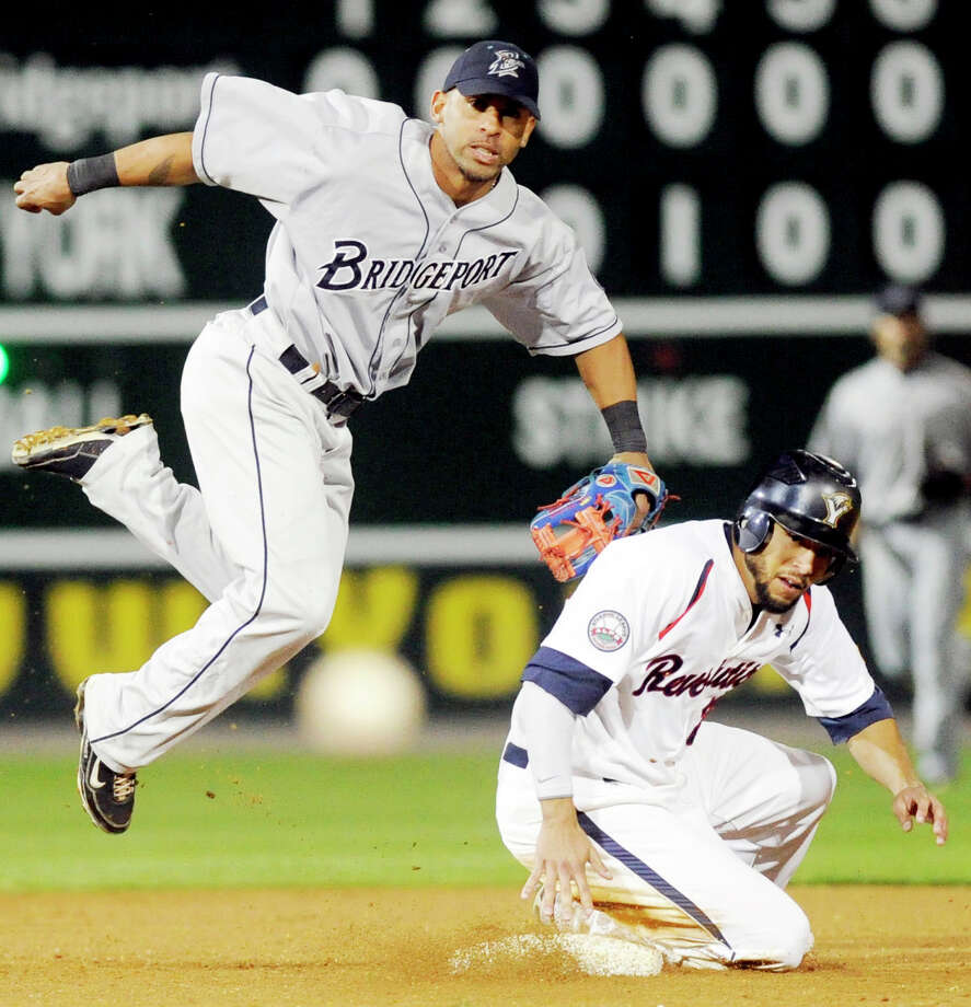 York Revolution's Scott Grimes watches the ball with Birdgeport's Hiram Bocachica after his take-out slide broke up the double play during Game 1 of the Atlantic League Championship Series Wednesday, September 29, 2010. Grimes was out but his slide kept Liu Rodriguez alive.  Photo: York Daily Record/Sunday News, Kate Penn /