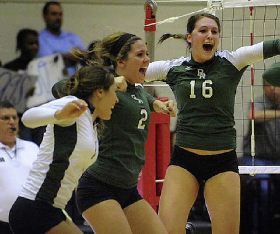 Jamie Merriam, left, Brooke Curtis and Kayla Keller of Reagan High School celebrate their victory 3-2 victory over Johnson in District 26-5A volleyball action at Littleton Gymnasium on Wednesday, Sept. 29, 2010.