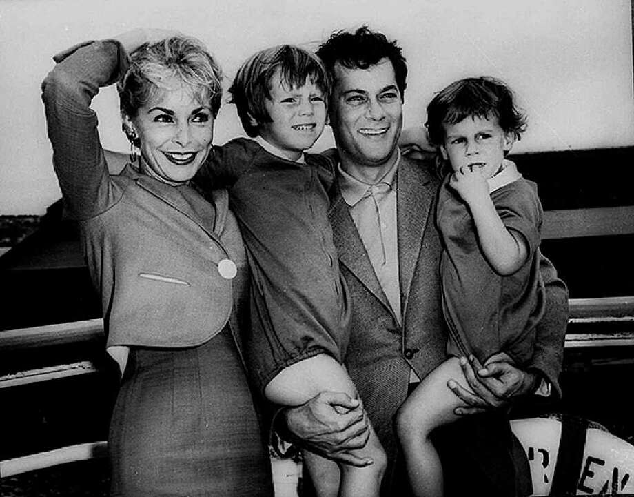 "FILE - Tony Curtis and Janet Leigh pose with their children, Kelly 5, and Jamie, 2 1/2  in this Sept. 19,1961 file photo prior to their departure on the SS Argentina for the Argentine where Curtis was to do location filming for the movie ""Taras Bulba."" Curtis died Wednesday Sept. 29, 2010 at his Las Vegas area home of a cardiac arrest at 85 according to the Clark County, Nev. coroner. (AP Photo/HO - File) Photo: Anonymous, AP / AP1961"