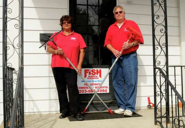 Couple opens fish window stamfordadvocate for Fish window cleaning