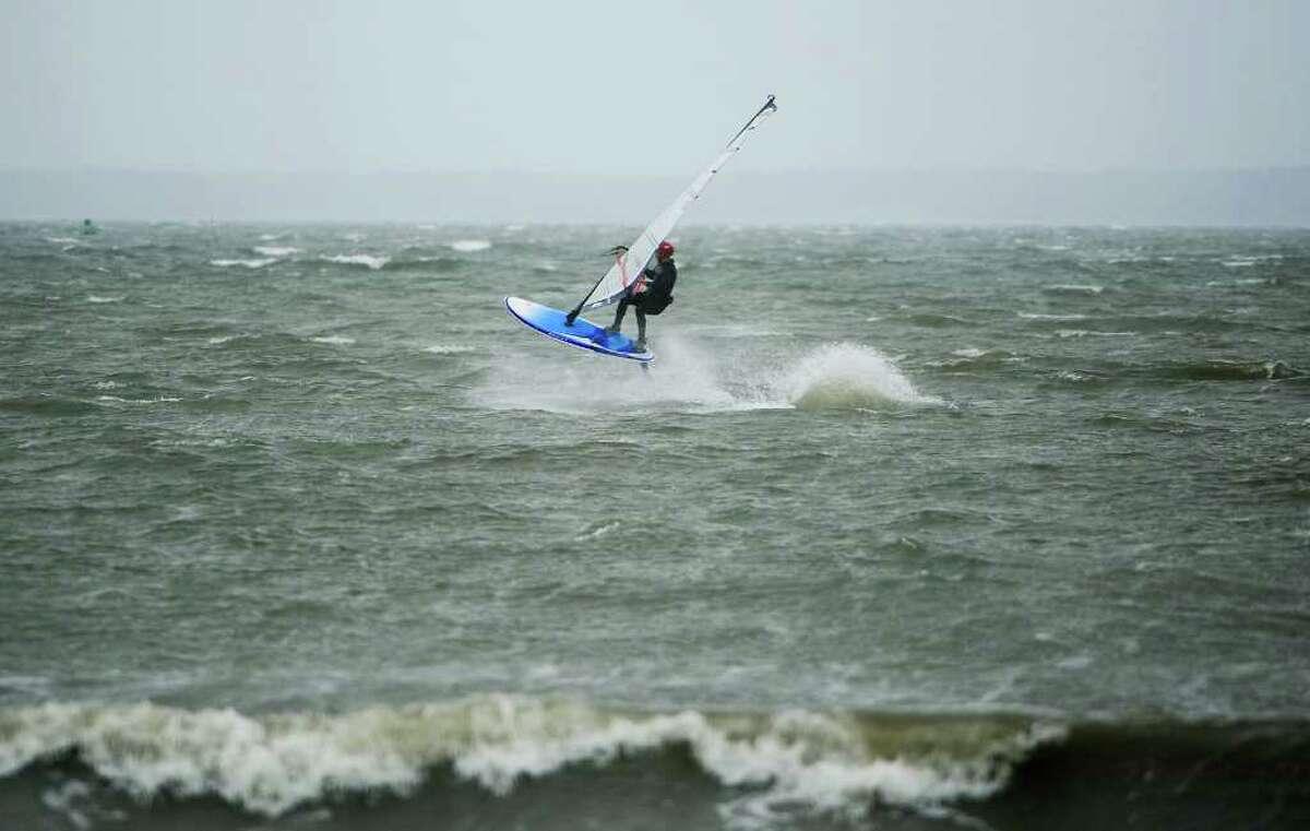 Bill Fishman, of Stamford, windsurfs at Cummings Beach in Stamford, Conn. on Thursday September 30, 2010.