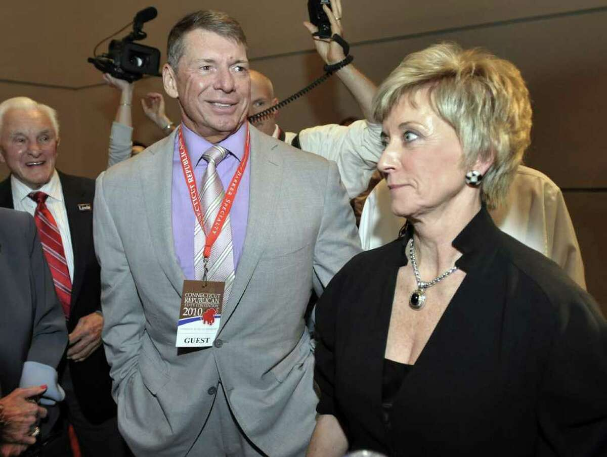 Republican candidate for U.S. Senate Linda McMahon, right, and husband Vince McMahon, left, wait for delegate totals to be tallied during the Republican nomination at the Connecticut Republican Convention in Hartford, Conn., Friday, May 21, 2010. (AP Photo/Jessica Hill)