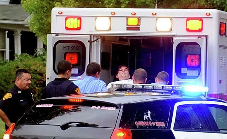 Shawn Welch, 31, of Bridgeport, is loaded into an ambulance after engaging police in a car chase during which he forced several cars off the road, including a police officer who drove into a sign. Welch sustained minor injuries during a physical altercation with police and is charged with reckless endangerment, tampering with evidence, interfering with police, engaging plice in pursuit and reckless driving. Photo: Lindsay Niegelberg / Connecticut Post
