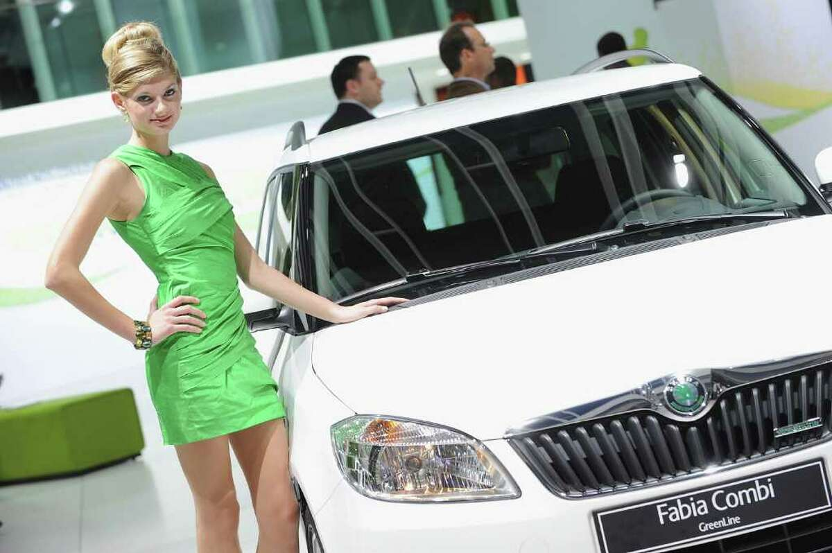 PARIS - SEPTEMBER 30: A model stands next to a Skoda Octavia car during a press day at Parc des expositions Porte de Versailles on September 30, 2010 in Paris, France. (Photo by Francois Durand/Getty Images)