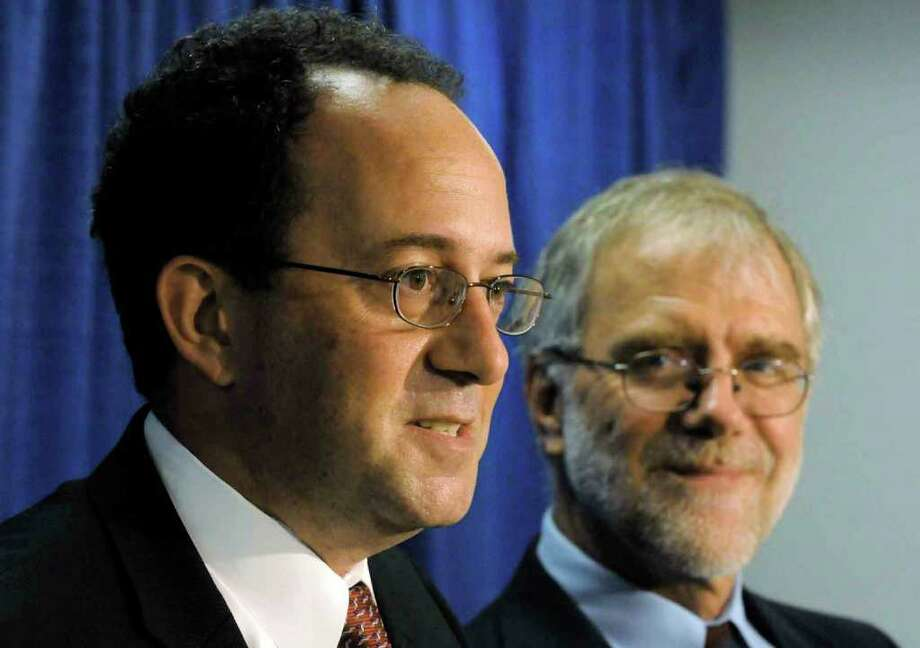 Warren Redlich, left, the Libertarian nominee for governor, and Howie Hawkins, the Green Party nominee for governor call for organizers of gubernatorial debates to include them in upcoming events during a Thursday news conference at the Capitol in Albany. (Michael P. Farrell / Times Union) Photo: Michael P. Farrell