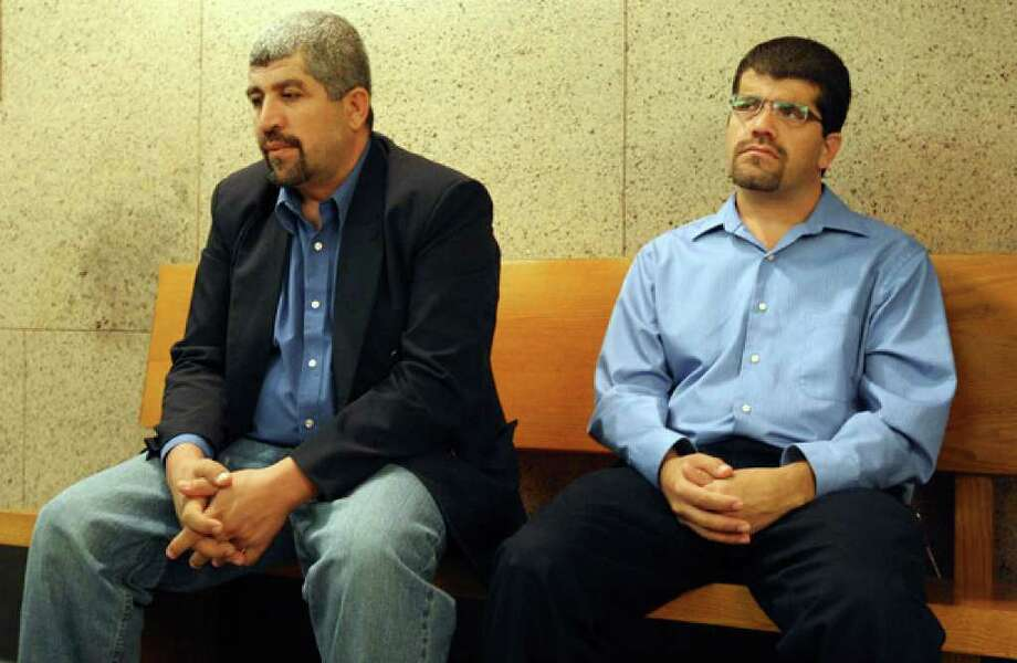 "Mohammed ""Moe"" Omar's brothers Joe Omar (left) and Hasan Omar sit outside the courtroom. Hasan Omar testified that Moe Omar came to the U.S. from Jordan in 1985 and that running the store, which he opened in 2006, was his dream."