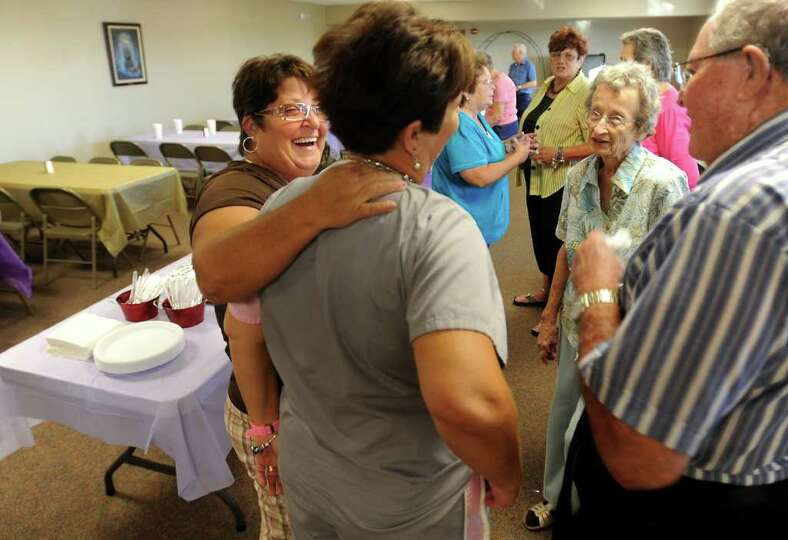 Members of the Sabine Pass community mingle before the Methodist Church's pot luck fellowship gather