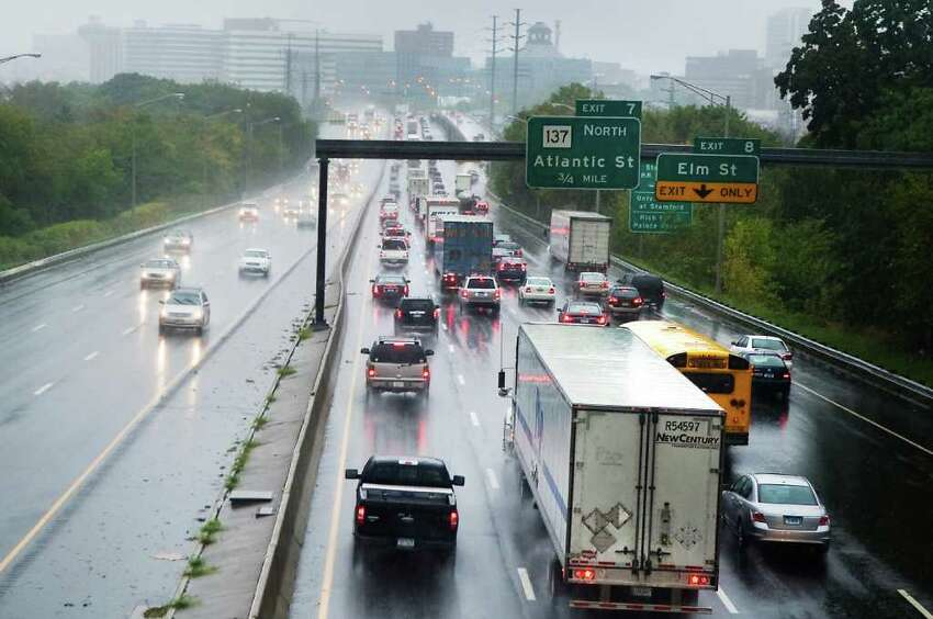 Traffic piles up on I-95 southbound through downtown Stamford during morning rush hour as high winds and rain hit the area on Friday October 1, 2010.